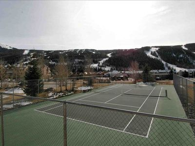 Play tennis while looking at the mountains!