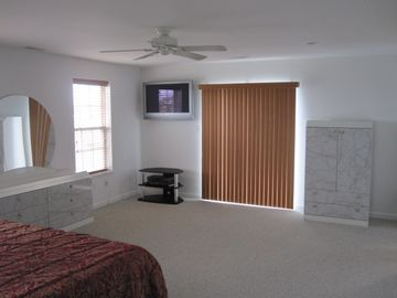 Master Bedroom with slider and Plasma TV