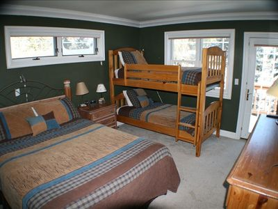 Upstairs bedroom with queen and twin bunk beds.  Shares a Jack-and-Jill bathroom