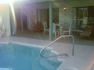 Palm Coast house photo - View of the pool and the Lanai, have coffee, wine, and watch the fish jump!
