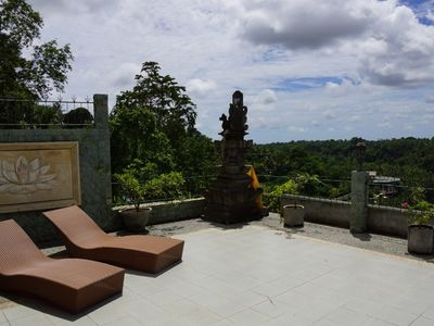 Private terrace with Balinese altar and sun loungers
