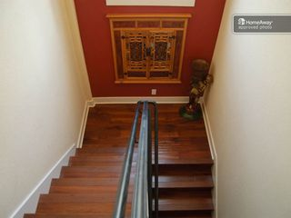 Austin house photo - Walnut Antique stair case with wrought iron hand rail.