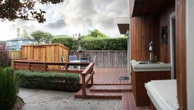 The front entry and deck are charming and perfect