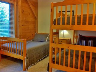 Right: The upstairs right bedroom has a bunk bed and twin bed. Sleeps three.