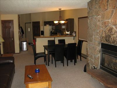 Open dining, kitchen and living areas.