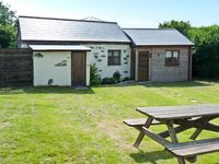 CONTENTION BARN, pet friendly, with a garden in Penhallow, Ref 20090