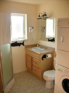 downstairs bath with a washer/dryer