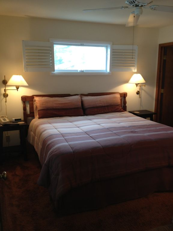 The master bedroom features a king size bed, private bath & flat screen TV.