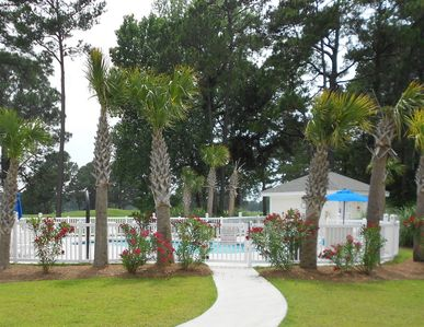 Magnolia Pointe condo rental - One of 3 pools, just a short walk. Landscaping is well done!!