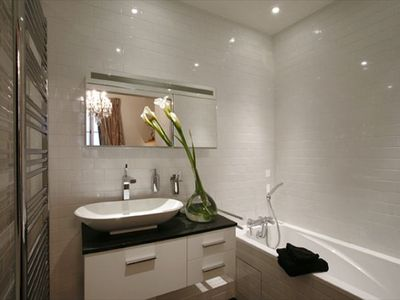 Master bathroom with Full Size Bathtub AND Shower - Master bathroom with Full Size Bathtub AND shower.  You can notice the luxury furnishings.  There is a full size shower to the left.  Notice the high quality furnishings in the property.