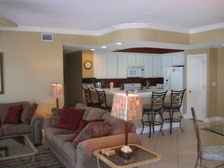 Orange Beach condo photo - Open Concept Living! Queen Sofa Sleeper in Foreground & DR to Right.