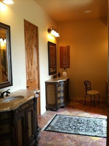 master bath with his & her's vanities