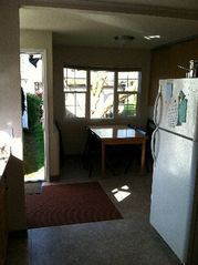 Portland house photo - Kitchen through door and nook window into backyard. The table expands to hold 10