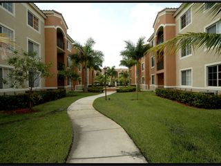 South Miami condo photo - Tropical landscaping, pathways inside gated community