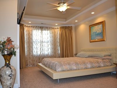 Large master in soothing neutral decor & king bed. Luxury linens/custom drapes.