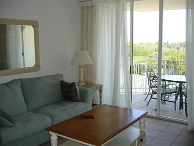 Key West condo rental - Living Room and Balcony - Sofa opens into a queen-size bed