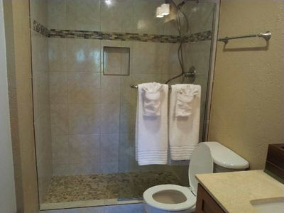 Newly renovated bathroom with glass