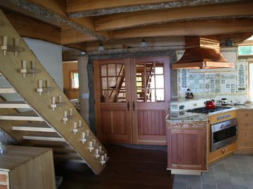Pantry, kitchen, and stairs leading to the second floor.