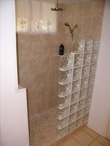 Walk-In Glassblock shower with pebblestone floor