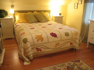 Comfy queen bed with twin trundle across room