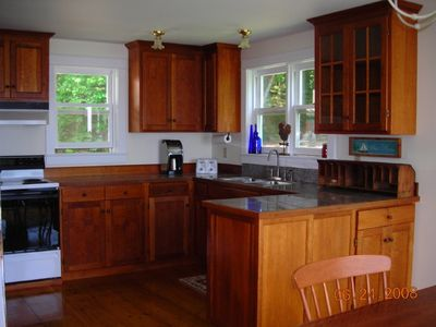 Custom cherry kitchen with pumpkin pine floors