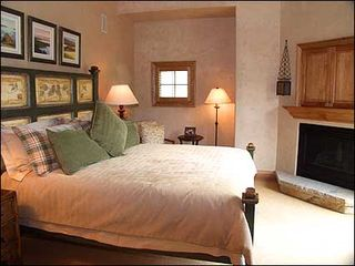 Snowmass Village house photo - Master bedroom with king bed, gas fireplace, Jacuzzi, bath, and deck, TV/VCR/DVD
