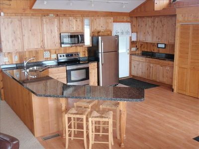 Renovated kitchen w/plenty of space to prepare meals & enjoy the view!