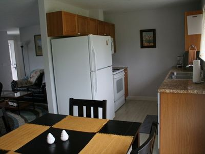 Full kitchen including coffee maker, microwave, dishwasher, stove top and oven.