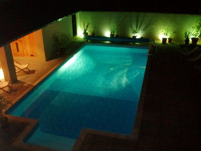The pool and sauna by night from upstairs