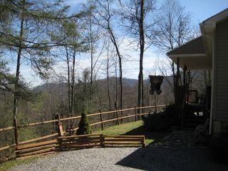 Maggie Valley house photo - View of mountain range from front & sides of home