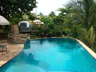 Vieques Island house photo - Pool view to the vintage airstream and private deck with outdoor shower and bath