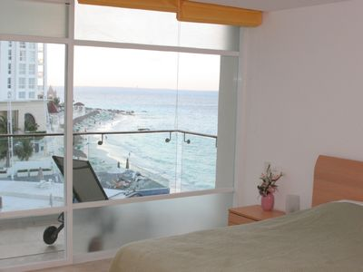 2nd bedroom with ocean and pool view