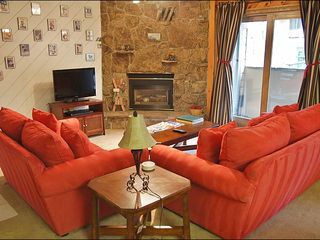Steamboat Springs condo photo - Living Room has VERY comfy suede couches, fireplace, HDTV, DVD & VCR.