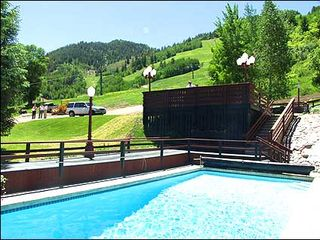 Aspen condo photo - Heated Pool with slopeside views