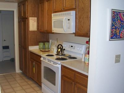Kitchen - new electric stove with new microwave overhead