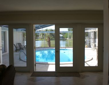 Luxuryhome w/View walking into front door pool access via 5 sets of French doors
