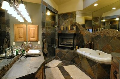 Part of the Master Bath with a Huge Walk-in Shower, Fireplace & Jacuzzi Tub.