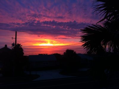 "Amelia Island house rental - sunrise from inside sliding glass doors in ""great room"" leading out to balcony"