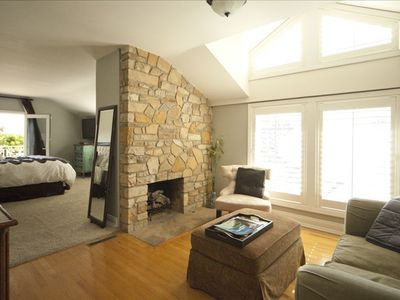 Primo's Sitting Room offers a stonework fireplace and lounge seating.