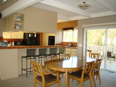 Kitchen and dining area with view of barbeque deck