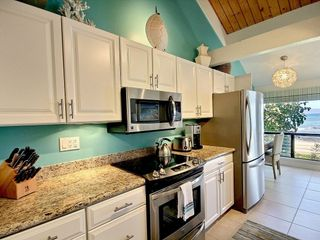Kahana condo photo - Kitchen: all-new stainless steel appliances, granite countertops, tropical decor