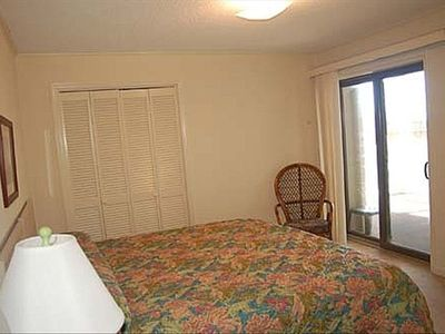 Master bedroom has a king size bed and direct access to the large balcony.