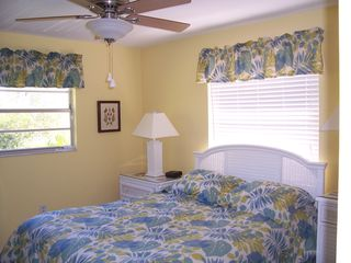 Sanibel Island house photo - Our bright and cheery Guest Bedroom has a comfortable queen an 32 inch LCD TV