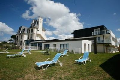 These apartments are in a residential complex with a swimming pool and are by a beautiful sandy beach.