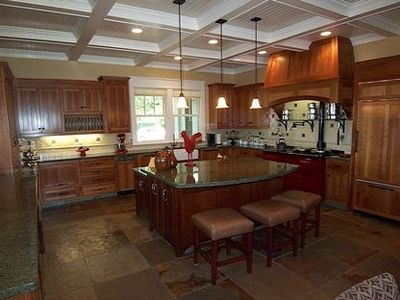 Chef's delight kitchen w/ coffered ceilings, sinked isalnd, subzero fridge