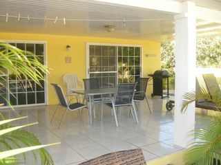 Aruba villa photo - Large shaded patio with bbq grill looks out at the pool & garden No crowds here!