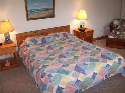 Ocean Sands cottage rental - Grnd Floor bedroom w/queen, TV, attached half bath and an outdoor shower closeby