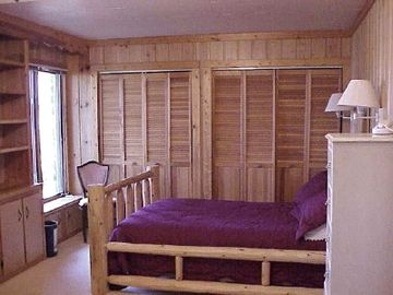 The Downstairs Bedroom Features a Hand Carved Log Bed Plus a View of the Lake!