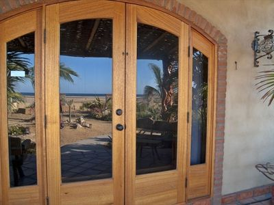 view of the front door with reflection of the Pacific Ocean just steps away