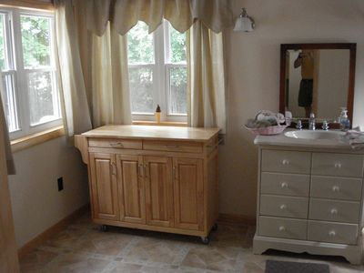 Plattsburgh cottage rental - A spacious half bath is convenient to the back bedroom with twin beds.